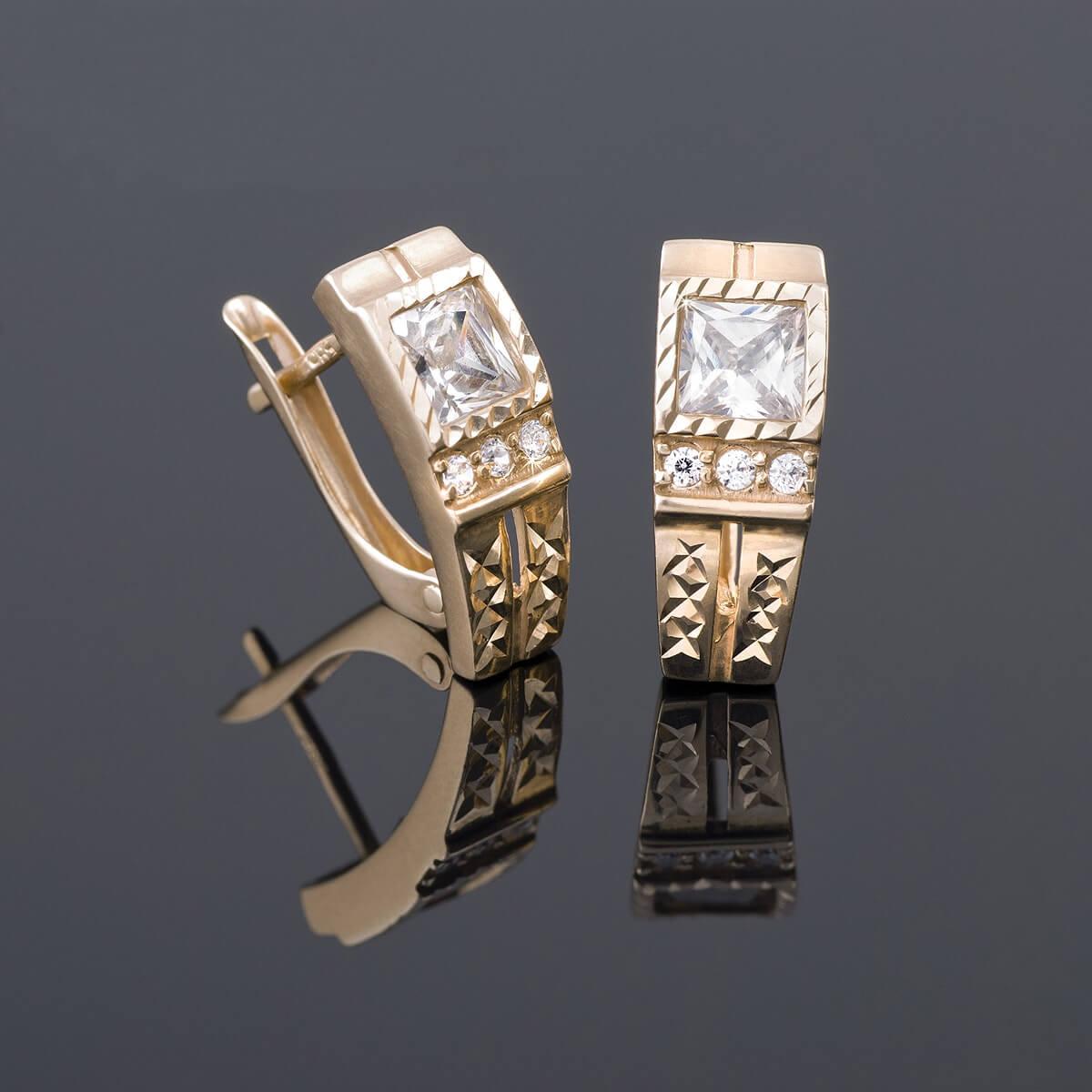 złote kolczyki z dużymi brylantami